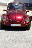 Old car beetle. Old and colored car beetle parked stock image
