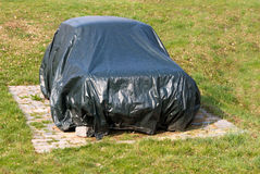 Old car beneath cover Royalty Free Stock Photography
