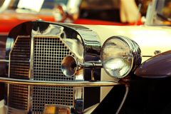 Old car with big headlights Royalty Free Stock Images