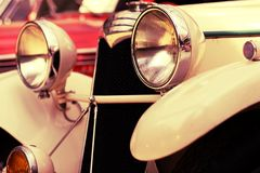 Old car with big headlights Stock Photo