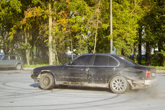 Old-car BMW 5-series e34 drifting Royalty Free Stock Image