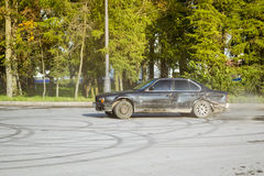 Old-car BMW 5-series e34 drifting. SAINT-PETERSBURG, RUSSIA - AUGUST 3, 2013: Old-car BMW 5-series e34 drifting on the road, meeting fans of the Bavarian Royalty Free Stock Photos