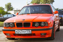 Old-car BMW 5-series e34. SAINT-PETERSBURG, RUSSIA - AUGUST 3, 2013: Old-car BMW 5-series e34, at the meeting, fans of the Bavarian automaker, Krestovsky island Royalty Free Stock Photos