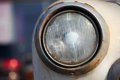 Old Car Broken Pobeda lights. Street city Stock Photos