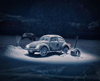 Old car broken in the snow and a supposed alien abduction Royalty Free Stock Photography