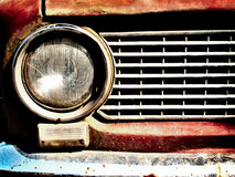 Old car bumper. Rusty old car light and bumper closeup Royalty Free Stock Images