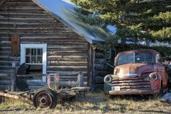 Old car and cabin in Carcross, Yukon Canada. stock photography