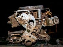 Old car carburetor. Old carburetor of a car in a dark parking garage Stock Photos