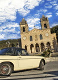 Old car and cathedral of Gibilmanna. Old car and the background of the shrine Gibilmanna royalty free stock photos