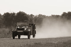 Old car on a country road Royalty Free Stock Image