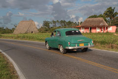 Old car on countryside road near Vinales Royalty Free Stock Photos