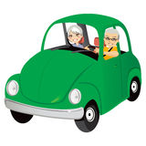 Old Car Couple. Senior couple happy driving cute old green car Royalty Free Stock Photos