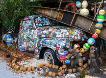 Old car covered with a variety of stickers Stock Photos