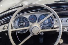 Old car dashboard and instrument claster royalty free stock photography
