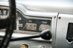 Old car dashboard sign ooil and temp Royalty Free Stock Photo
