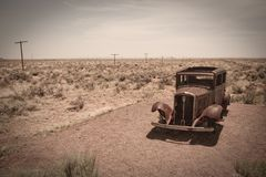 Old car and desert