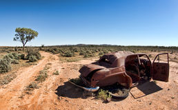 Old car in the desert Stock Photography
