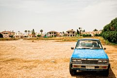 old car in desolate landscape Stock Photography