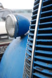 Close up of the front of an old blue car. At a car cemetery in New Zealand Stock Images