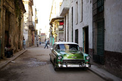 Old car in downtown backstreet Havana Royalty Free Stock Images