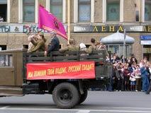 Old car drives the street at military parade Stock Photo