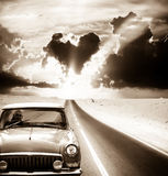 Old car driving on  road Royalty Free Stock Image