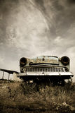 Old car at field. Photo in old image style.  Royalty Free Stock Photo