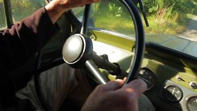 Old car goes through the countryside. stock video footage