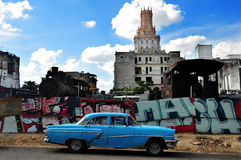 Old Car in Havana. Old car and old train machines in the center of Havana, Cuba Royalty Free Stock Photos