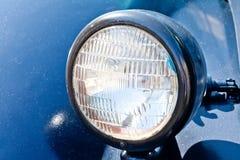 Old car headlight. Retro style. Dark blue. Classic. Royalty Free Stock Photo