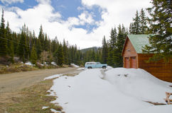 Old car and house and snow around in Colorado Royalty Free Stock Image