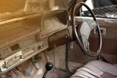 Old car interior. Old car interior with the steering wheel and dashboard Stock Photos
