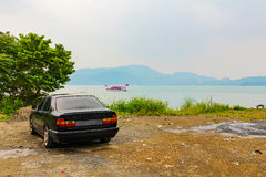 Old car by a lake Royalty Free Stock Photography