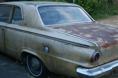 Old car. Left rear of old car with rust Stock Images