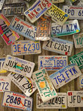Old car license plates on the wall Royalty Free Stock Photos