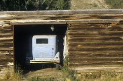 An old car in a log cabin garage in Snowmass, Colorado Royalty Free Stock Photo