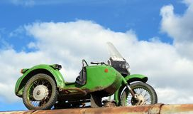 Old car and motorcycle, Lithuania. Two old transports -car and motorcycle stock photography