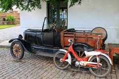 Old car and motorcycle parked in historic quarter of Colonia del Royalty Free Stock Images