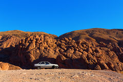 An Old Car in a Mountain Landscape Royalty Free Stock Photography