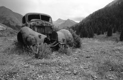 Old car in mountains. Old car in mountans,old rusty car in muntains,junk car with mountain view, old car in Jan Juan mountains Colorado,old car in mountains Stock Image