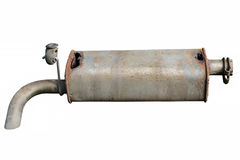 Old car muffler. Front and corrosion damage. Royalty Free Stock Photo