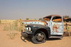 Old car in Namibian desert royalty free stock photography