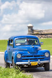 Old car near the castle of El Morro in Havana Stock Photography