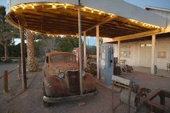 An old car at an old antique gas station in California near Death Valley National Park entrance Stock Photo
