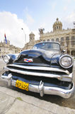 Old car parked in front of the Revolution museum in Havana, Cuba Royalty Free Stock Photography