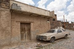 Old car parked in Real de Catorce Mexico. May 22, 2014 Real de Catorce, Mexico: an old car parked on the cobblestone street of the mostly abandoned high altitude Stock Image