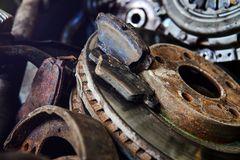 Old car parts with shallow depth of field. Old rusty car parts with shallow depth of field royalty free stock photography