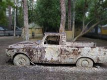 Old car photo. Paintball location royalty free stock photo