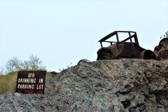 The Desert Bar, Parker, Arizona, United States. An old car on the property of The Desert Bar, situated in the Buckskin Mountains located in Parker, Arizona Royalty Free Stock Photography