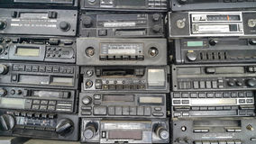Old, Car Radios in Workshop. Old, car cassette radios stacked on top of each other on the shelves in car service Royalty Free Stock Photo